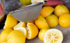 Bright yellow lemons are cut in half on a table